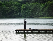 A man angling at the lake, a popular branson rainy day activity