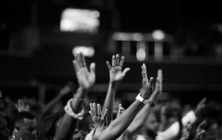 grayscale-photography-of-people-raising-hands-2014775
